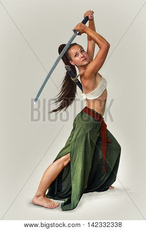 Young flexible girl in the image of the Japanese warrior sword on a light background. The picture is drawn with digital painting.