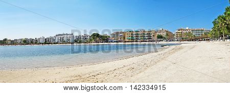 Alcudia Majorca Spain - June 26 2008: Beach panorama of Alcudia with hotels promenade and beach with water of mediterranean sea in front