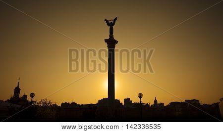 Statue of Independence in Maidan Nezalezhnosti (Independence square) during sunset Kyiv Ukraine