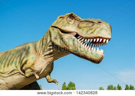NOVI SAD SERBIA - AUGUST 7 2016: Tyrannosaurus life size model of prehistoric animal in theme entertainment Dino Park. T-rex was one of the largest land carnivores of all time.