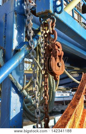 Rusty chains and ropes on a fishing trawler