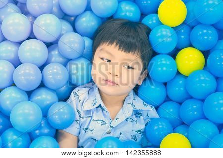Asian Boy in a colorful Ball pool