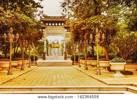 View at the ornamental gate in the Traditional Chinese Garden The Baomo Garden In Guangzhou China