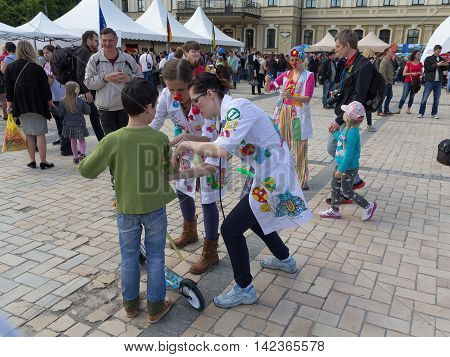 Kiev Ukraine - May 21 2016: Actors in the role of clowns to entertain children during the celebration of Europe Day