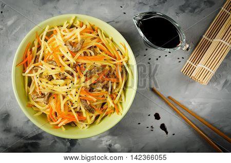 Asian food - potato salad kamdi-cha. Salad with garlic peppers and soy sauce