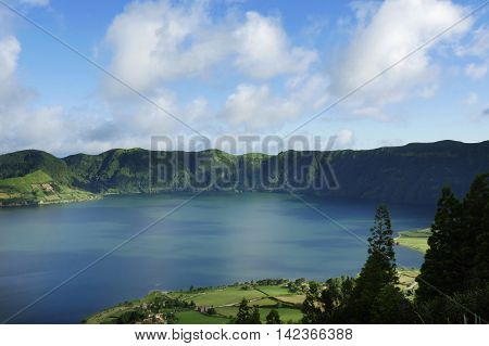 amazing beautiful scenic landscape view of Blue Lake or Lagoa Azul in Sete Cidades of Sao Miguel island of Azores in Portugal in holiday tourism and vacation travel destinations concept