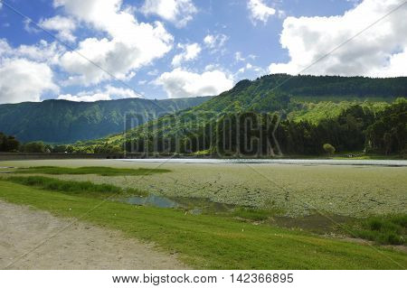 amazing beautiful scenic landscape view of Green Lake or Lagoa Verde in Sete Cidades of Sao Miguel island of Azores in Portugal in holiday tourism and vacation travel destinations concept poster