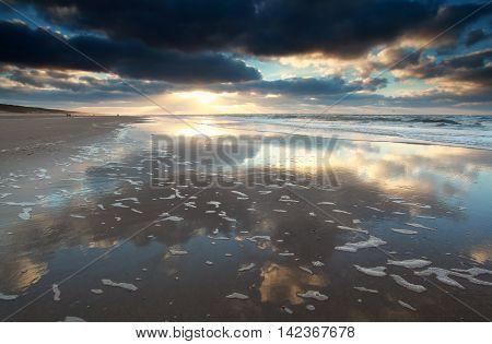 sunset on North sea beach North Holland Netherlands