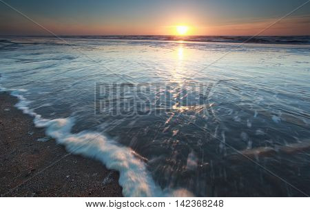 sunshine over North sea at sundown Netherlands