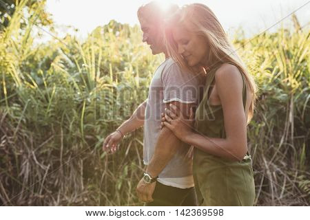 Loving Young Couple Walking In Countryside