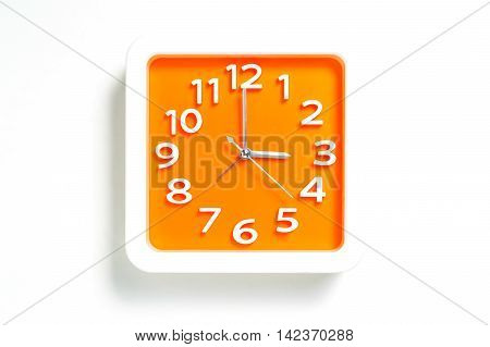 Orange Plastic Clock counting 3:00 o clock