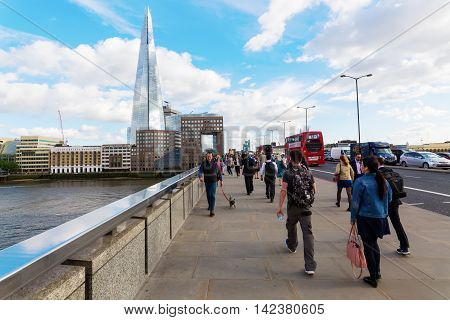 London UK - June 15 2016: unidentified people on the London Bridge. The bridge is often shown in films news and documentaries showing the throng of commuters journeying to work into the City