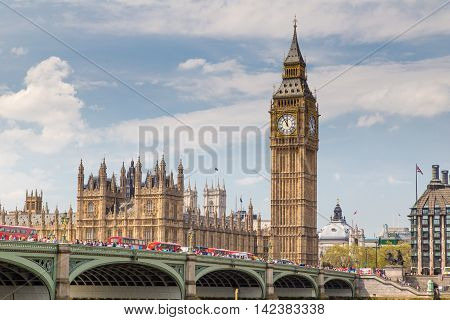 LONDON - May 06: London buses crossing Westminster Bridge near Parliament on May 06 2016 in London UK. London is one of the world's leading tourism destinations