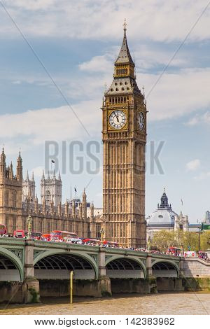 LONDON - May 10: London buses crossing Westminster Bridge near Parliament on May 10 2016 in London UK.