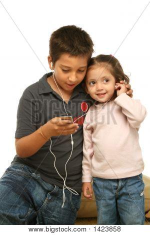 Children Enjoying A Mp4 Player Together