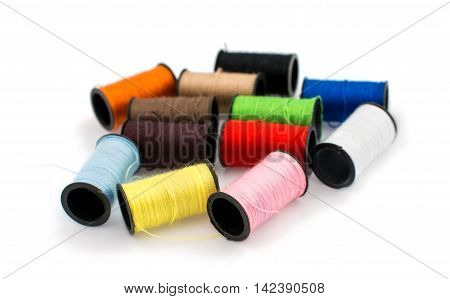 colored threads for embroidery on a white background