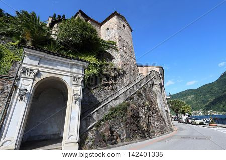 MORCOTE, SWITZERLAND - MAY 23, 2016: Village of Morcote facing Lake Lugano on May 23, 2016 in Morcote, Switzerland. It is a landmark resort at Lake Lugano.