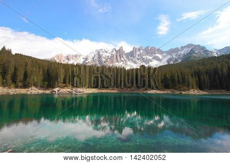 turquoise lake Carezza and the Italian alps Dolomites, Northern Italy