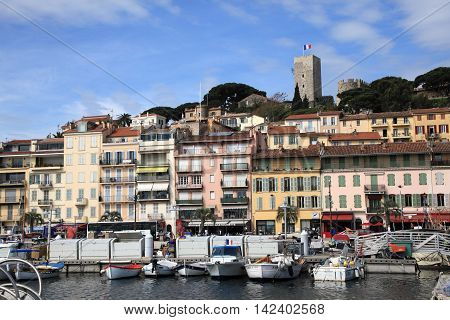 CANNES, FRANCE - MAY 1, 2015: Cannes cityscape viewed from the old harbour on May 1, 2015 in Cannes, France.