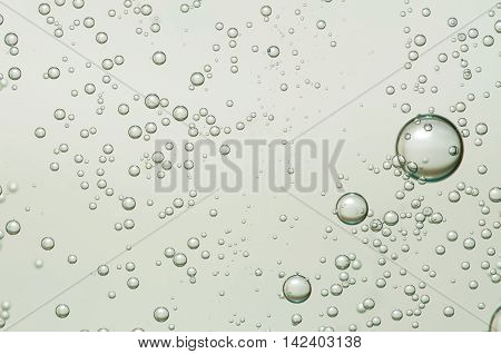 Champagne bubbles flowing over a light background