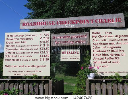 Roadhouse restaurant menu sign on dam across the zuidersee