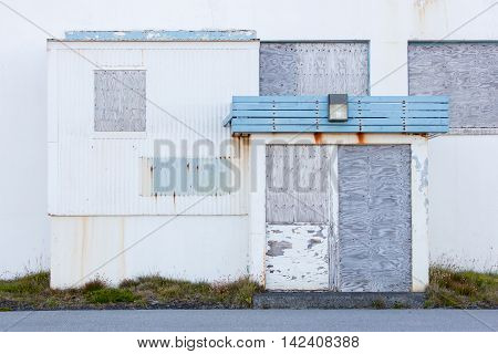 Front View Of A Boarded-up Abandoned Building In Iceland