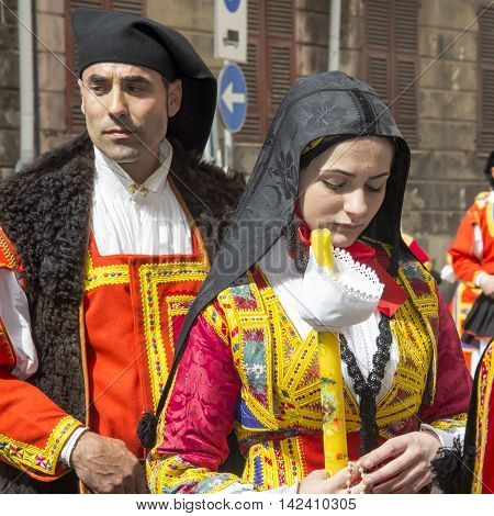 CAGLIARI, ITALY - May 1, 2013: 357 ^ Religious Procession of Sant'Efisio - Sardinia - portrait of young people in traditional Sardinian costume