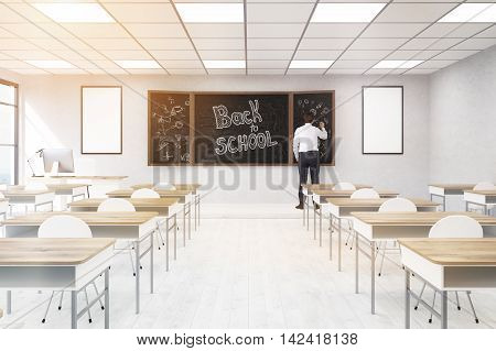 Male teacher in college classroom. Concept of providing education. Back to school. 3d rendering. Mock up. Toned image.