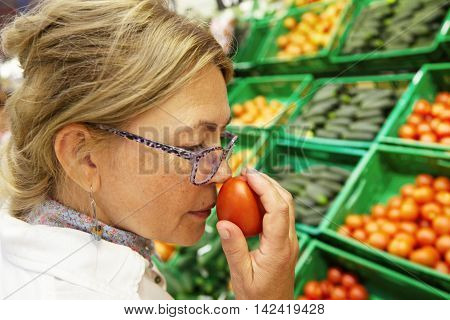 Food And Healthy Lifestyle Concept. Close Up Profile Portrait Of Beautiful Elderly Woman In Glasses