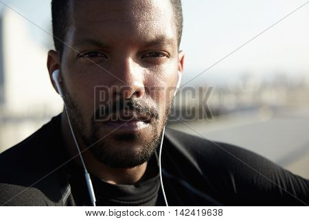 Close Up Of Handsome African Athlete With Healthy Tanned Skin And Confident Look, Wearing Black Spor