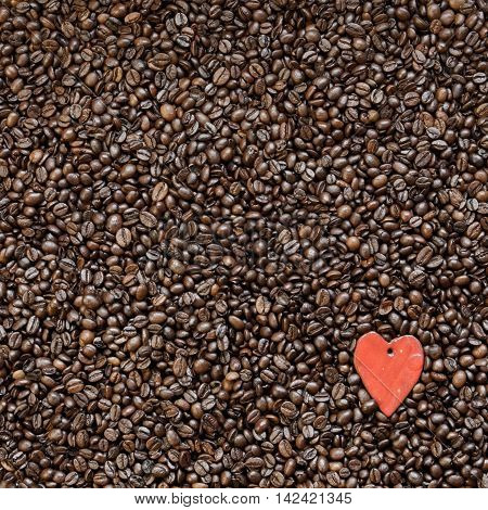 Roasted coffee beans and shape of heart as symbol of love