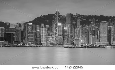 Black and White, Hong kong city skyline at night over Victoria bay with clear sky and urban skyscrapers