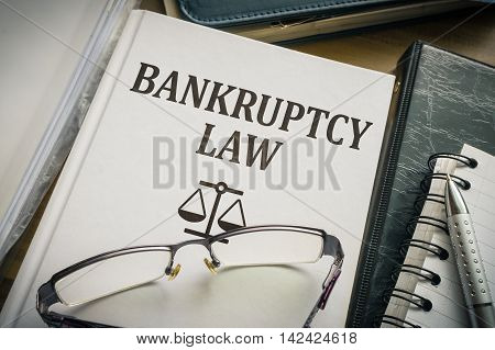 Bankruptcy law book. Justice and legislation concept.