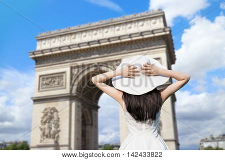 young woman wear dress and behind you with Triumphal arch