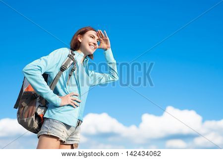 happy woman mountain hiker go to travel and look something with blue sky and white clouds caucasian