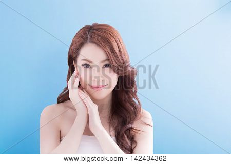 Beauty woman with charming smile to you with isolated blue background asian