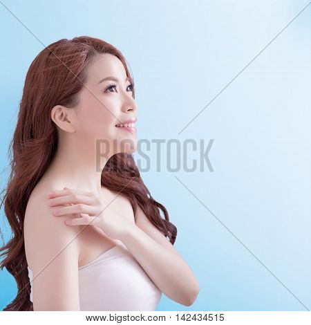 beauty skin care woman face and look some where with isolated blue background asian