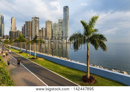Panama City Panama - March 18 2014: People jogging in a sidewalk near the Panama City Finantial District in Panama