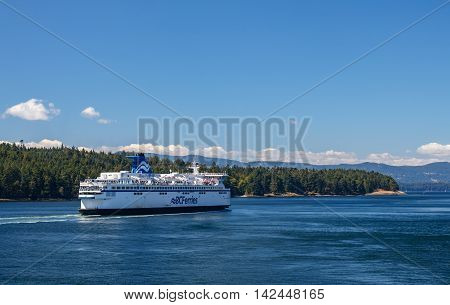 GULF ISLANDS BRITISH COLUMBIA CANADA - AUGUST 04 2016: BC Ferry passes Gulf Islands. BC Ferries provides an essential link from mainland British Columbia to the various islands.