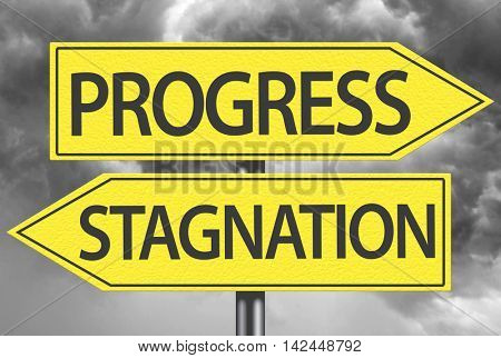 Progress x Stagnation yellow sign