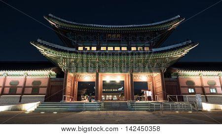 Illuminated Heungryemun Gate at night, south entrance to Gyeongbok Palace. Landmarks of Seoul, South Korea