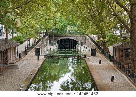 Canal Saint Martin in Paris with sluice and bridge