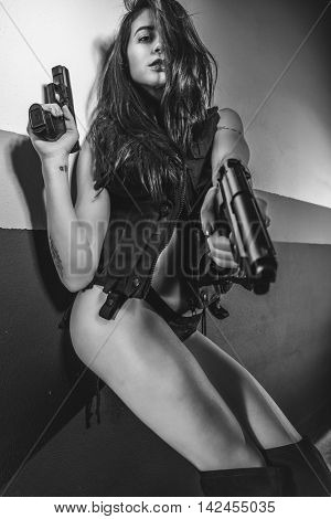 Fighter, brunette sensual and sexy with weapons in aggressive and dangerous position