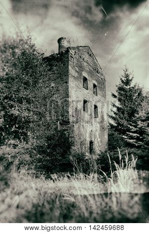 Old abandoned haunted house in grunge style