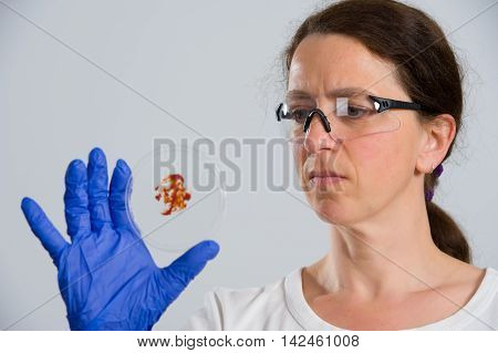 Female Lab Assistand With Petri Dish