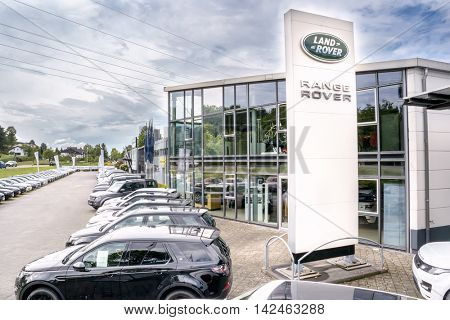 BADEN-BADEN, GERMANY - MAY 29, 2016: Office of official dealer Range Rover. Car  Range Rover fast speed drive off-road
