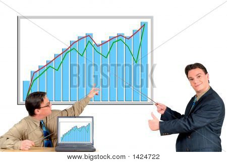 Young Businessman Pointing To Chart