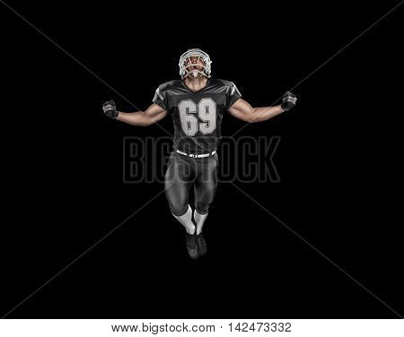 Professional american football player celebrates victory on black background