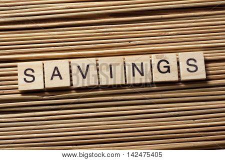 SAVINGS word written on wood block. Wooden abc