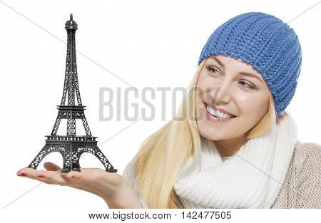 Beautiful blonde holding model of Eiffel Tower . Isolated on white.